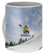Woman Snowboarding On The Cinder Cone Coffee Mug by Kate Thompson