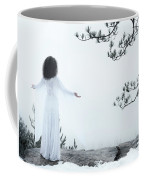 Woman Standing On A Cliff With Spread Hands Embracing The World Coffee Mug