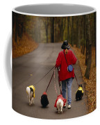 Woman Walks Her Army Of Dogs Dressed Coffee Mug by Raymond Gehman