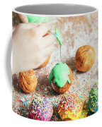 Woman's Hand Coating A Donut With Green Frosting. Coffee Mug
