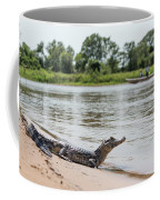 Yacare Caiman On Beach With Passing Boat Coffee Mug