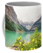 Yellow Flowers At Lake Louise Coffee Mug