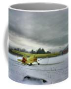 Yellow Plane In Winter Coffee Mug
