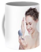 Young Beautiful Woman Applying Powder On Her Skin. Coffee Mug
