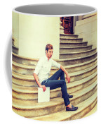 Young Businessman Sitting On Stairs, Relaxing Outside Coffee Mug