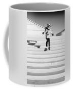 Young Child Jumping Down Steps Coffee Mug