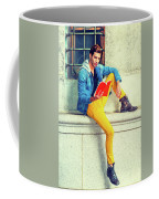 Young Man Reading Red Book, Sitting On Street Coffee Mug