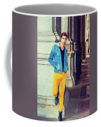 Young Man Standing On Street, Relaxing Outside Coffee Mug