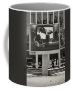 Young Woman And Outdoor Television Display Coffee Mug