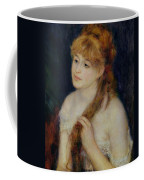 Young Woman Braiding Her Hair Coffee Mug by Pierre Auguste Renoir