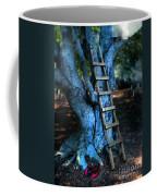 Young Woman Climbing A Tree Coffee Mug