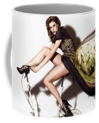 Young Woman In Long Dress On Exercise Bike Coffee Mug