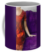 Young Woman In Red On Purple Couch Coffee Mug by Jill Battaglia