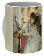 Young Woman Powdering Her Face Coffee Mug