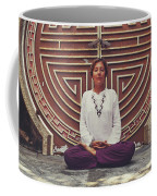 Young Woman Sitting And Meditating In A Lotus Position In Front Of A Unique Doors Coffee Mug