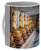 Golden Buddhas Coffee Mug by Adrian Evans