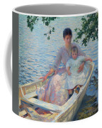 Mother And Child In A Boat Coffee Mug