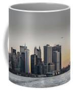 Panoramic View Of Manhattan Island And The Brooklyn Bridge At Su Coffee Mug by PorqueNo Studios