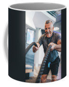 Senior Man Exercising With Ropes At The Gym. Coffee Mug