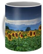 Sunflowers Under A Stormy Sky Coffee Mug by John De Bord
