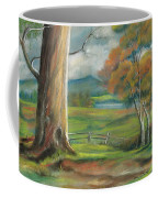 Tree In The Meadow Coffee Mug by Val Stokes