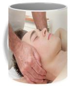 Teenage Boy Laying On A Massage Table Coffee Mug