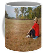 A Woman Is  Sitting In A Park And Admiring The Landscape Coffee Mug