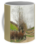 Autumn Weather. A Man With A Wheelbarrow On A Path Coffee Mug