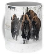 Bison Bulls Run In The Snow Coffee Mug