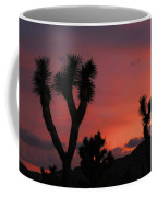Joshua Trees Silhouetted Against A Red Sky Coffee Mug