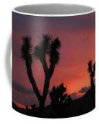 Joshua Trees Silhouetted Against A Red Sky Coffee Mug