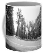 Low Angle View Of Sharp Turn Through Dense Forest Coffee Mug by PorqueNo Studios