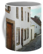 medieval cobbled street in Culross, fife Coffee Mug