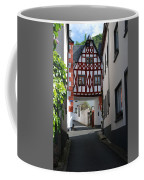 old historic street and woodframed house in Ediger Germany Coffee Mug