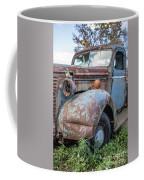 Old Vintage Blue Pickup Truck Among The Weeds Coffee Mug