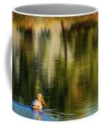 Pelican In Sunlight Coffee Mug by John De Bord