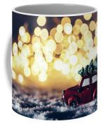 Red Car With Christmas Tree Driving Through Snow Coffee Mug