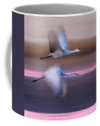 Sandhill Cranes Flying Over Lake Coffee Mug