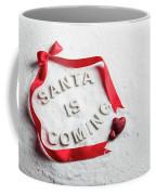Santa Is Coming Text And Red Ribbon Coffee Mug