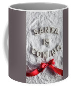 Santa Is Coming Writing And A Red Bow Coffee Mug