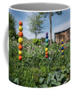 Sticks With Colorful Balls In A Garden Coffee Mug