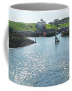 sunlight glistening on water at Eyemouth harbour Coffee Mug