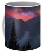 Sunset Storms Over The Rockies Coffee Mug by John De Bord