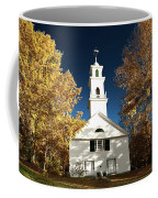 Sutton Meeting House Surrounded By Golden Fall Foliage Coffee Mug by Jeff Folger