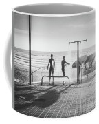 Three Surfers Rinsing Off In A Beach Shower After Surfing Coffee Mug by PorqueNo Studios