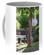 tree lamp and old water pump in Cochem Germany Coffee Mug
