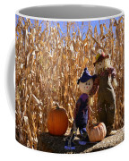 Two Cute Scarecrows With Pumpkins In The Dry Corn Field Coffee Mug