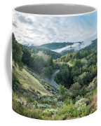 View Of Curved Road Through Dense Forest Area With Low Clouds Ov Coffee Mug
