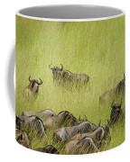 Wildebeest In Tall Grass Coffee Mug by Mary Lee Dereske