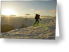 A Man Backcountry Skiing At Sunset Greeting Card